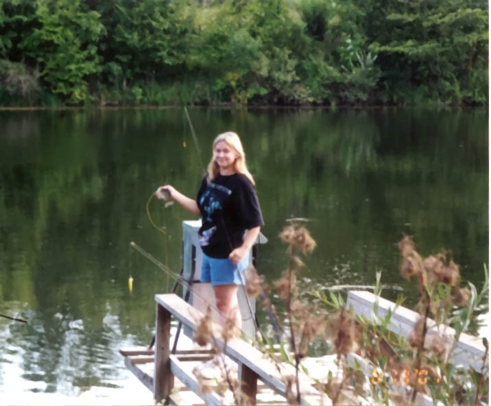 "Angel at ""Phil's Place"" catching bluegills"